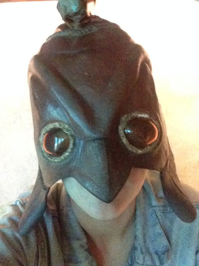 """This researcher demonstrates the proper wearing of an """"Ancient Atlantian Warriors Helmet."""""""