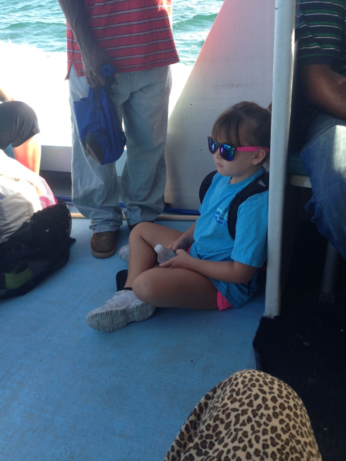 This kid was NOT having it on the ferry ride over. She is also, coincidentally, my childhood self transported into the future.