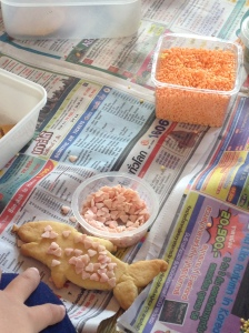 My contribution: decorating shark sugar cookies. n.b. we didn't have a cookie cutter.