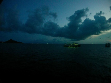 the night was full of clouds, the sea with boats. even night dives in koh tao are jam packed.