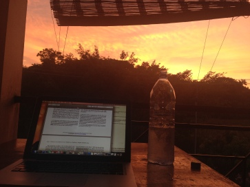 a sloppy shot, reading and writing at sunset.