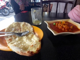 MADE IT TO PENANG, which I was nervous I'd miss. Amazing naan and cauliflower from the famous Kapitan restaurant, and damn fine tea.
