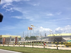I am trying so hard not to read nto the silimarities between the colors on Brunei and Shell's flags.