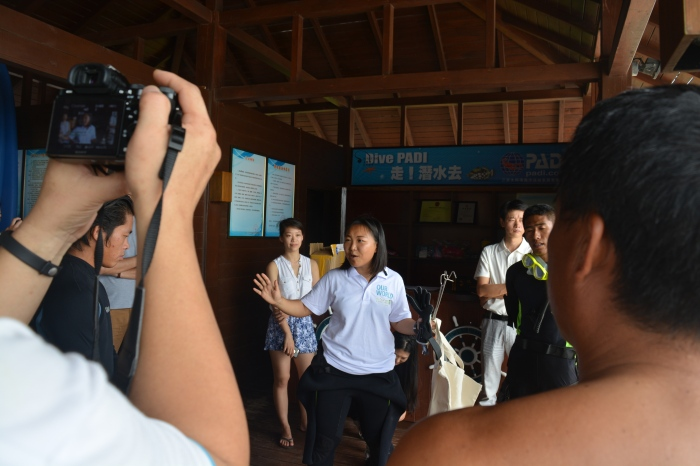 Jun gives the dive briefing at the event, hoping to clean up the reef and boost local investment in the TNC project.